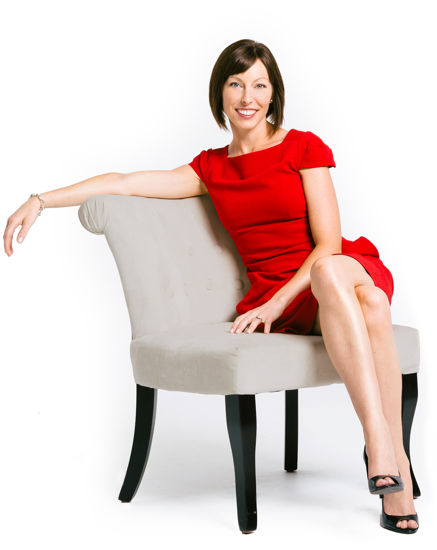 Katie Wagner Sitting on a Chair in a red dress