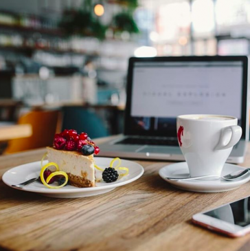 Misused Facebook Insights | Katie Wagner Social Media | Coffee shop and cafe workspace with MacBook being used to work along with a plate of pie and a cup of coffee