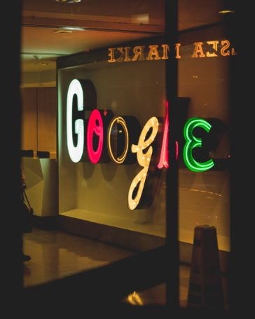 neon google sign through window