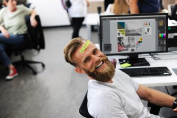 Bearded fellow having fun at his desk