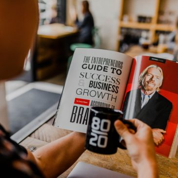 An entrepreneur reading about business growth.