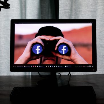 man with binoculars on desktop screen