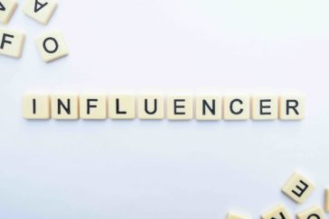 influencer in scrabble letters