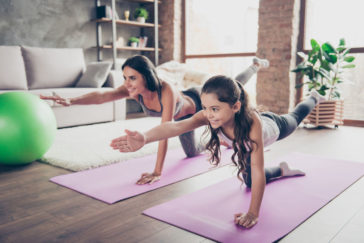 3 benefits of using Pinterest for your fitness brand, people doing yoga at home