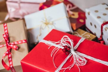 wrapped holiday gifts piled on top of one another