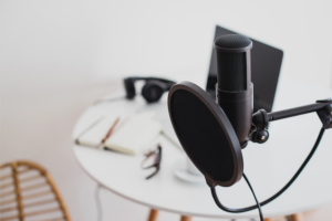 podcast microphone in front of small workspace area